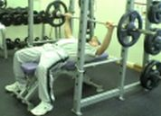 man doing barbell chest press