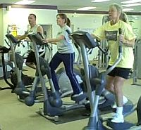 3 people on elliptical machine